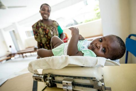 6 month old baby is weighed at a routine health care visit