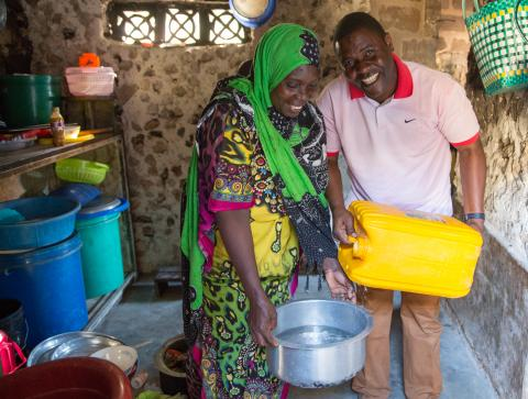 Couple testing water to make sure its safe of cholera