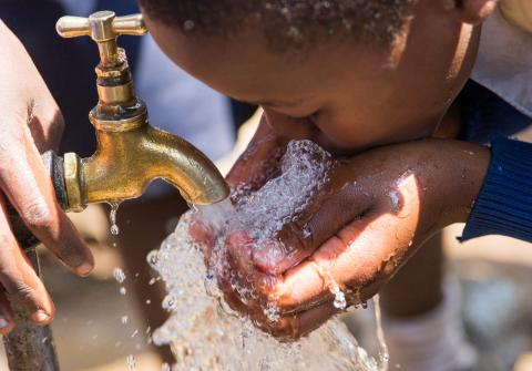 Child drinking safe water