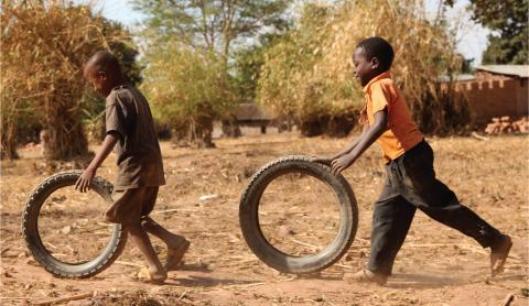 Children playing with tyres