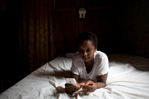 16-year-old girl loads credit to her mobile phone