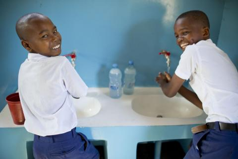 Two boys washing hands