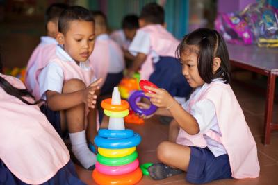 Children are playing with learning materials and toys