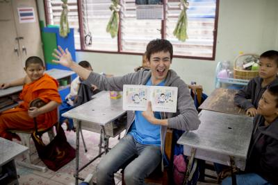 Nichkhun Horvejkul is talking playfully with students in the class.