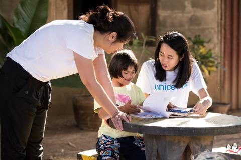 UNICEF Staff are engaging with a little girl