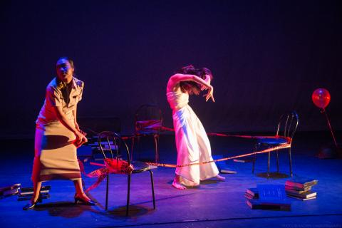 Two people are doing performance on a stage.