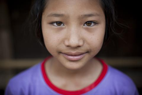 A close-up portrait photo of a young girl
