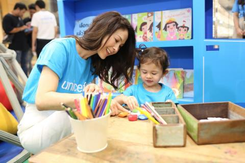 Paula Taylor, friend of UNICEF, and her daughter, Louella playing kids'toy at EatPlayLove expo