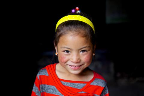 A smiling girl, Qinghai Province, in 2013.