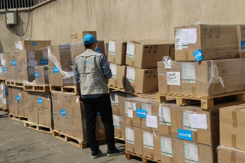 UNICEF staff and officials from the Iranian Ministry of Health, Treatment and Medical Education (MoH) visit a warehouse where the UNICEF humanitarian aid is stored and distributed to hospitals and medical universities admitting Covid19 patients.