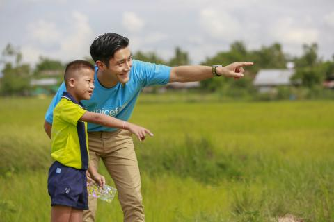 SiWon and a boy standing in rice field together