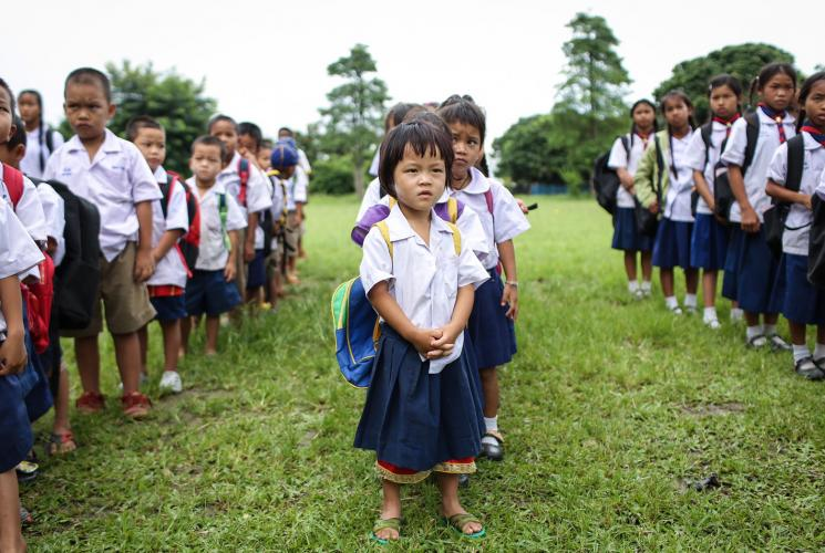 Migrant Student standing in the field