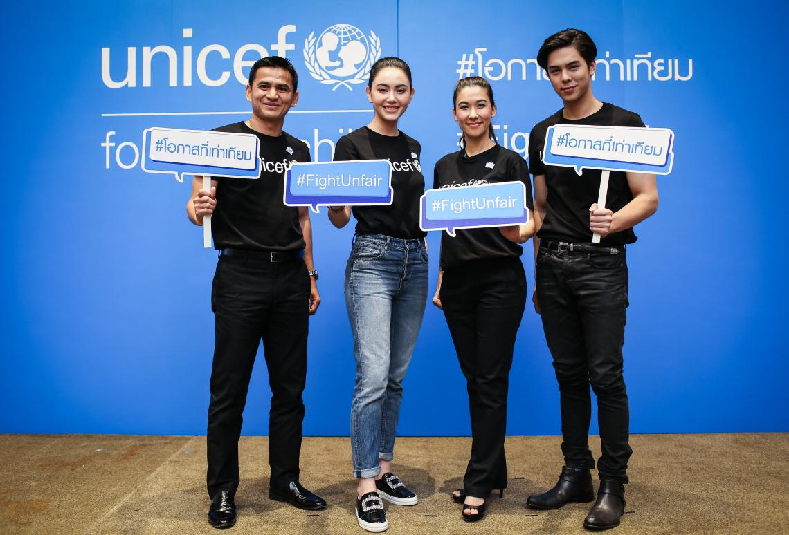 Four new Friends of UNICEF are standing together while holding a sign to promote #FightUnfair campaign.