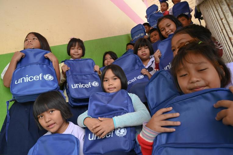 Children at Ban Tapthai School in Ubon Ratchathani received school bags distributed by UNICEF and Ministry of Education for the new semester