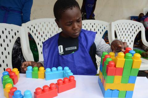 A boy plays with building blocks