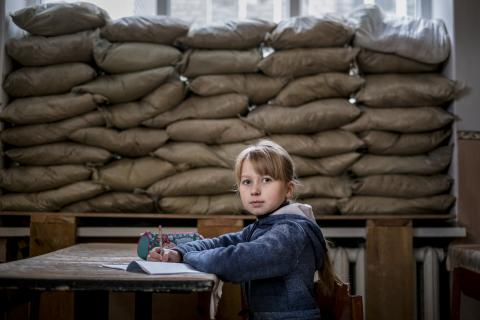 Lera Nagormay, 10, sits for a photograph in a classroom at school in Marinka, Donetsk Oblast, Ukraine.