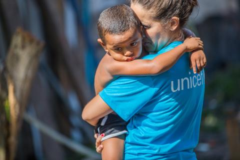 UNICEF staff member with a child in Brazil