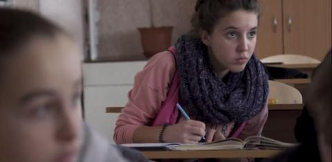 13-year-old Dasha writes in her notepad at school located near the contact line in eastern Ukraine.
