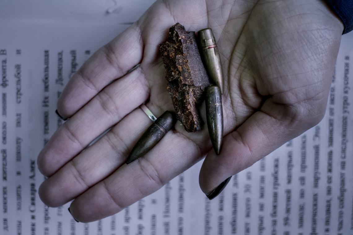Oksana Deynega, the director of school number 4, holds a shell fragment and bullets recently collected from the school grounds in Avdiivka, Donetsk Oblast, Ukraine, Monday 27 November 2017.
