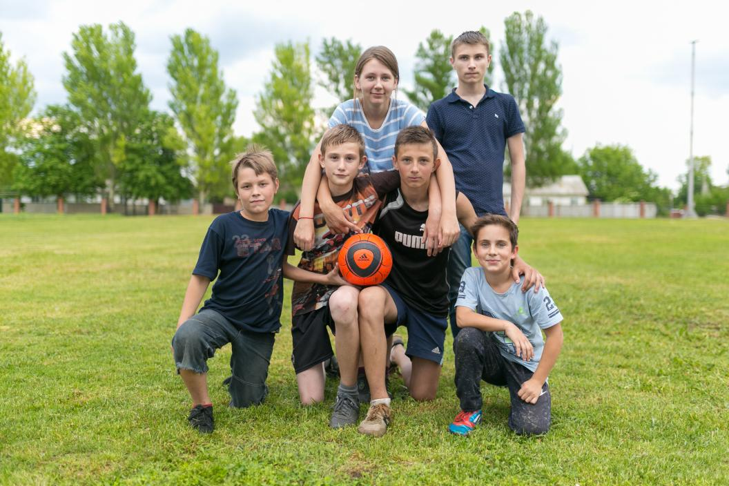 "Children who play football together on the outskirts of Donetsk are all of different ages and from different grades. They met and became friends at the football field near their school No.71. ""Dima just came to me and said ""let's be friends"" And since then, we play together,"" says Dima Silchenko, 12 years old."