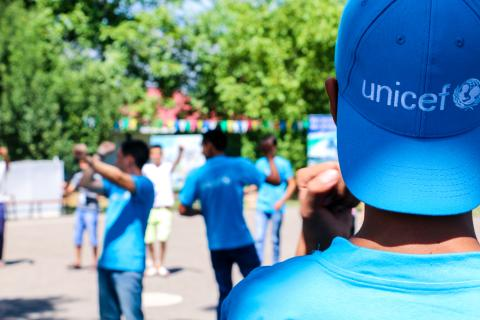 youth in UNICEF branded t-shirts and caps