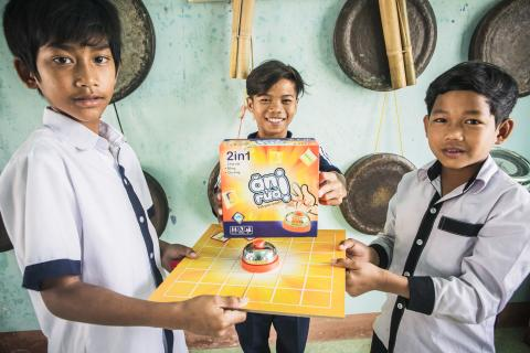"For Nhang (pictured left) and his classmates from Pi Nang Tac ethnic minority boarding school in Ninh Thuan province, playing UNICEF's innovative ""Cool Down the Earth"" and ""Eat - Poo - Wash"" board games are the highlight of their school day. The games, while fun and engaging, also build their knowledge and curiosity to better understand climate change and reinforce attitudes towards hand washing with soap and general sanitation practices."