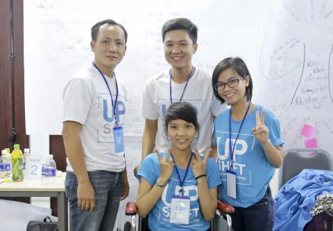 From left to right: Mr.Vo Duc Duy (mentor), Nguyen Thanh Lanh (supporter), Phan Thi Kim Van & Nguyen Thi Thuong (participants in blue T-shirts),  UPSHIFT Workshop.
