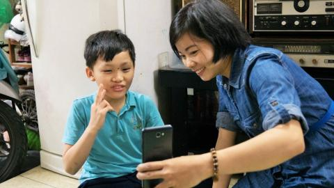 Tran and Tong Thi Nga's son, Vuong, catch-up over a FaceTime chat