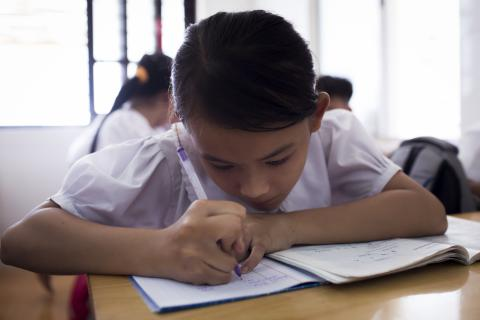 Tran Thi Ngoc Nhu, 11, studies in her class at Binh An Charity school in Ho Chi Minh city, Viet Nam, on July 22, 2020.