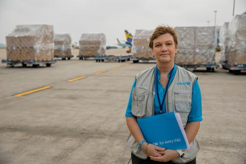 Ms Rana Flower, UNICEF Representative in Viet Nam stands in front of the first shipment of 811,200 doses of COVID-19 Vaccine supported by COVAX on 1st Apr 2021 at the Noi Bai International Airport.