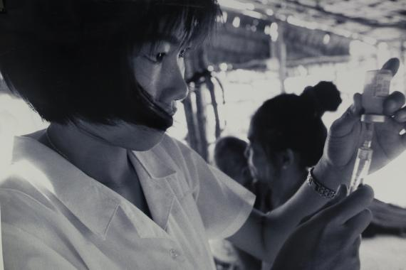 A health worker vaccinating children on a boat in the Mekong Delta, 1999.