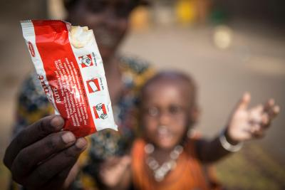 Nouhoum Hamar, who suffers from severe acute malnutrition, reaches for a sachet of ready-to-use therapeutic food