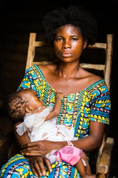 Lusamba Marie Katambua, 27, and her youngest daughter Banyi, 11 months, sit at home in Kananga, Kasaï region, Democratic Republic of the Congo, Saturday 20 January 2018.