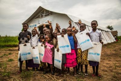 Students stand outside their temporary tent school setup by UNICEF, following a class in Mulombela village, Kasaï region, Democratic Republic of the Congo, Thursday 25 January 2018.