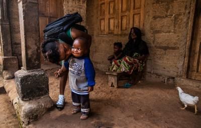 On 20 January, 18-year-old Mariatu Bangura kisses her son, Abdulai Kamara, at home before leaving for school, in Rokupr Town in Kambia District.