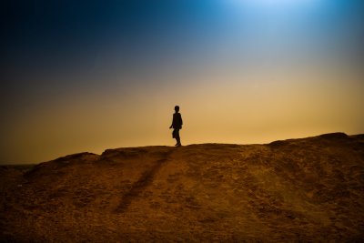 A boy walks on the sand bank surrounding M'Bera refugee camp.