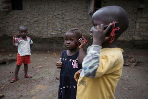 Children holding talkie walkies to their ear