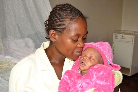 Mother holding her baby, Ebola survivors