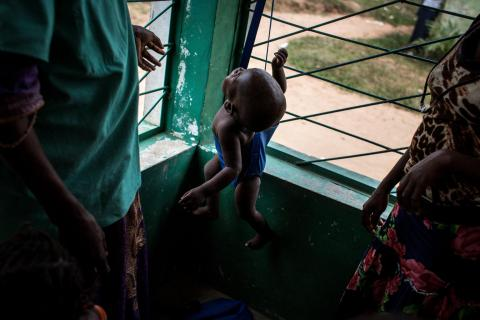 A baby gets his weight measured in a UNICEF supported child clinic in Nganza, Kananga.