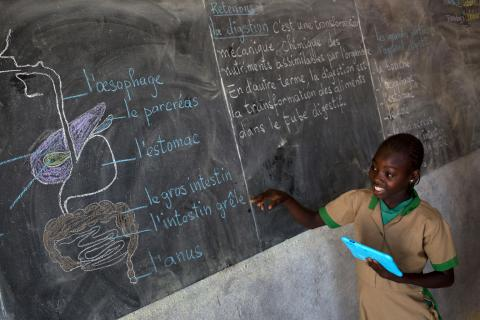 Twelve-year-old Waibai Buka, holding a UNICEF-provided computer tablet, speaks about the human digestive system in front of her class at a school in Bagai, northern Cameroon, Tuesday 31 October 2017.