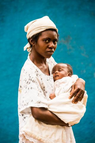 On 20 January 2018 in the Democratic Republic of the Congo, Bakena Mukendi cradles her sleeping, malnourished infant daughter, 1-month-old Bakatjika, at Saint Martyr Health Centre in the city of Kananga in the Kasaï region.