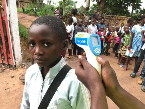 "On 30 May 2018 in the Democratic Republic of the Congo, students attending primary School ""Vie Nouvelle"" in Wangata neighbourhood must wash their hands and then have their temperature screened with a UNICEF-provided infrared thermometer before entering the school, in order to reduce the risk of Ebola Virus Disease (EVD) transmission in Mbandaka, the capital of Equateur Province."