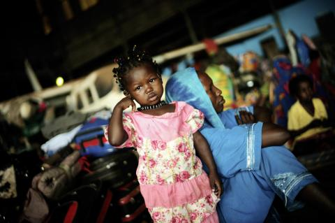 A young girl and her mother are among displaced people sheltering in a makeshift camp at the military airport on the outskirts of Bangui, the capital.