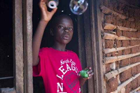 On 15 September 2018, Stephanie makes soap bubbles at her home in Mangina in the Democratic Republic of Congo.