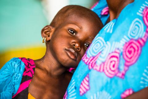 Fatou Youm, 46 years old, brings her grand daughter Tening Gueye who is 2 1/2 year old and suffers from malnutrition