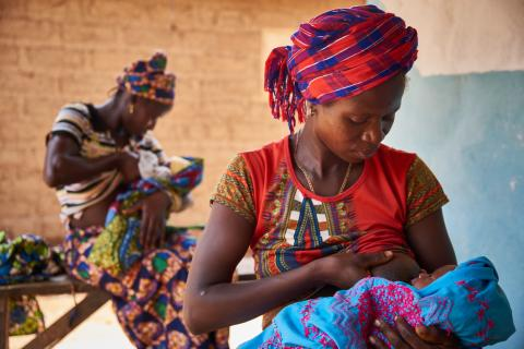 On 28 March, (foreground) Tenneh Mansaray breastfeeds her son, 9-day-old Manso Turay, in Bambaya Village in Fiama Chiefdom, Kono District.