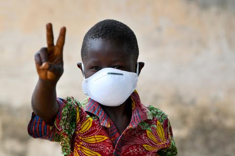 Boy wearing mask to protect himself from coronavirus