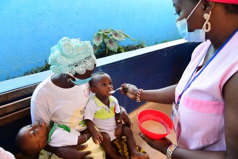 Nurses demonstrate how to make bouille to mothers to feed their children
