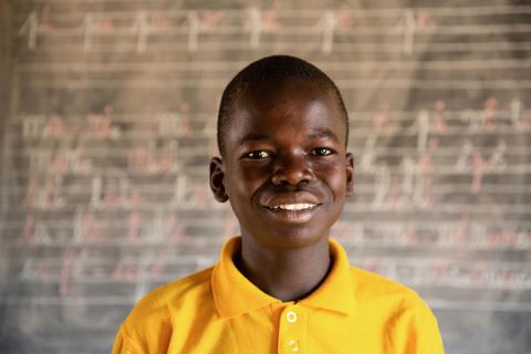 Portrait of a young boy in class smiling