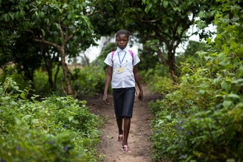 A young girl on the way to school in the Province of Kwilu
